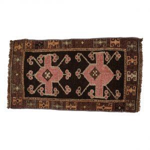 Tyrkisk kelim tæppe i brun og rosa. Tæpper sælges i København