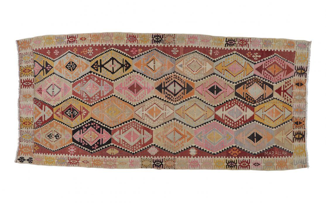 Tyrkisk kelim tæppe i gul og lyserød. Tæpper sælges i København