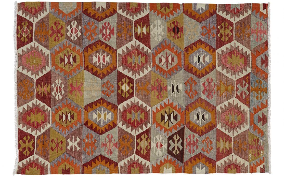 Kelim tæppe fra Tyrkiet i orange toner. Tæpper sælges i København