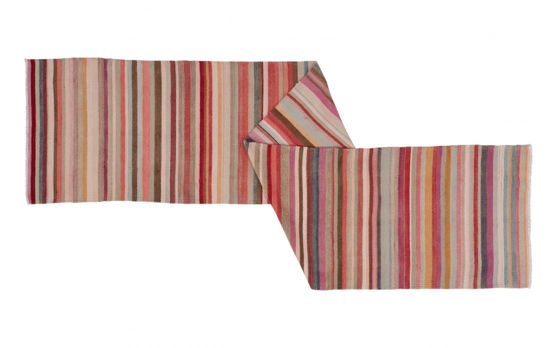 Stribet kelimløber i lyserøde farver fra Tyrkiet. Tæpper sælges i København